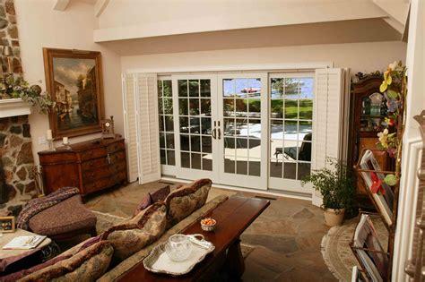 sunroom uses use a patio door on both sides of a sunroom