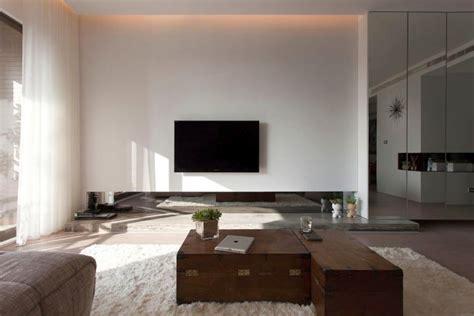 Modern Minimalist Living Room by Modern Minimalist Living Room With Mirror Wall Panel