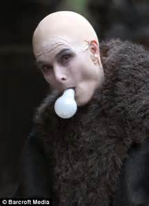 Appear like she had no hair she also carried a lightbulb in her mouth