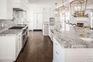 white cabinets with antique brass hardware white and gray kitchen with antique brass lanterns