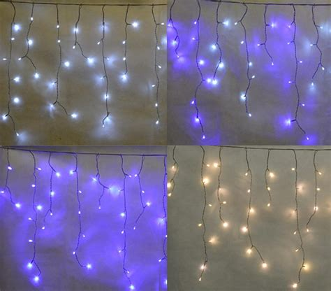 snowing icicle outdoor lights hausen icicle lights christmas true north distribution
