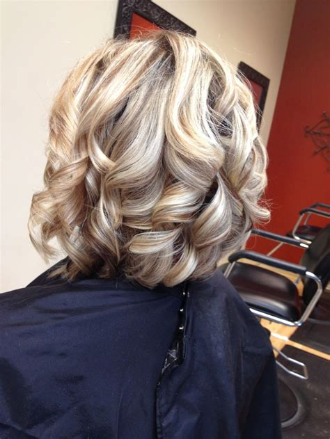 curly hair with lowlights deep lows and bright highlights on medium brown hair