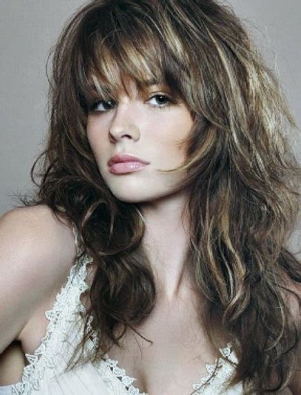 pictures of long hair withlight bangs layered and feathered back on top 20 long layered haircuts with bangs
