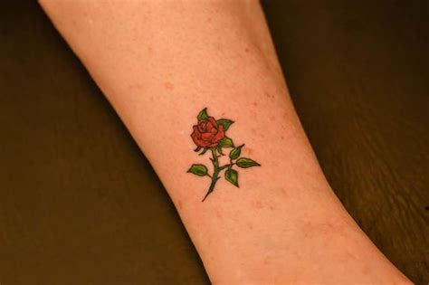 small rose tattoos on foot skulls with roses idea