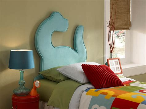 bedrooms with dinosaur themed wall and murals