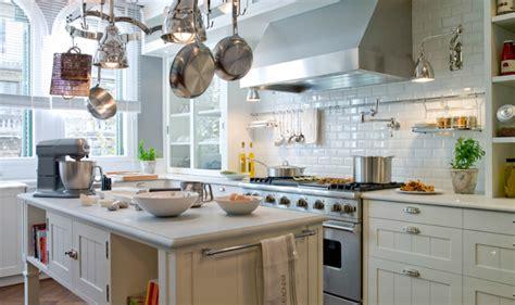 Light Grey Quartz Countertops by Glass Front Kitchen Cabinets Mediterranean Kitchen