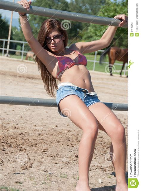 young girl up shorts young girl in the farm farm with top bikini and shorts