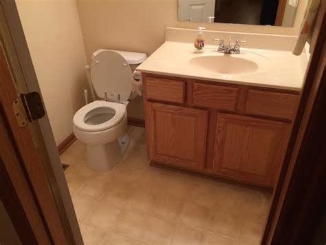 bathroom oak flooring oak cabinet in bathroom marble floors what do to with