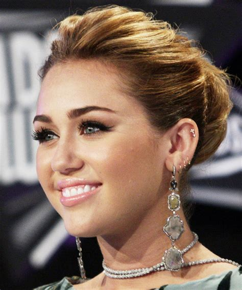 miley cyrus type haircuts miley cyrus curly formal updo hairstyle medium brunette