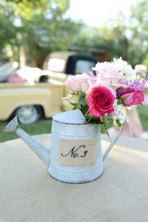 watering can centerpieces 1000 ideas about watering can centerpieces on mini watering can centerpieces and