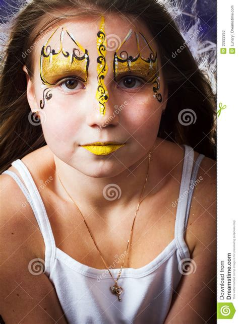 pretty girl  face painting  black background stock
