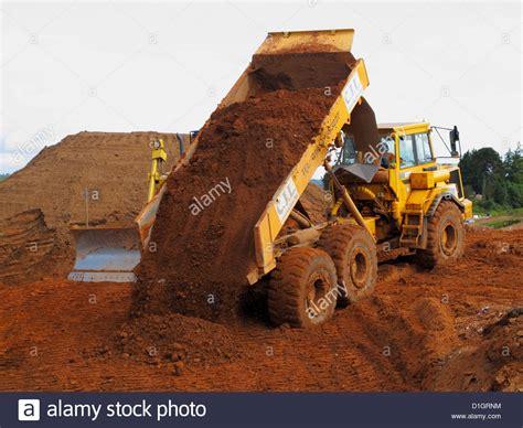 volvo tipper dump dumper  wheeled truck tipping soil  uk road stock photo royalty  image