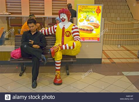 ronald mcdonald bench man on bench sitting next to ronald mcdonald in a large