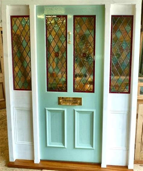 stained glass front door a stained glass front door with frame and sidelights