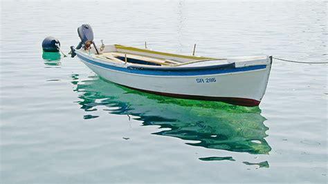 small boat fishing magazine small fishing boat anchored in marine croatia island