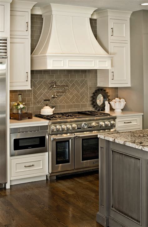 gray backsplash white cabinets gray and white kitchen with herringbone subway tile
