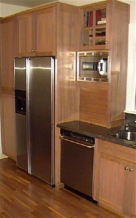 kitchen cabinets around refrigerator the essentially finished kitchen