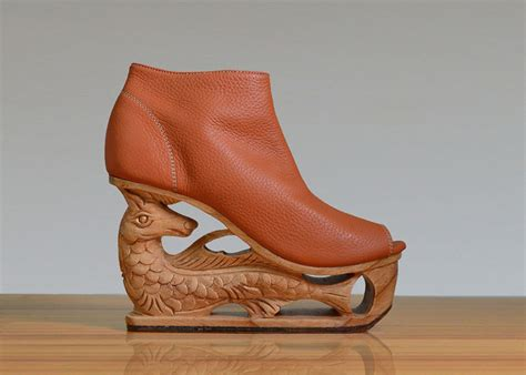 beautifully detailed wooden heels carved using ancient