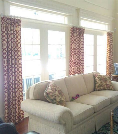 transom window covering hang drapes below the transome to show moulding