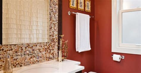 orange and brown bathroom accessories rust orange and brown dominate the color scheme in this single vanity bathroom