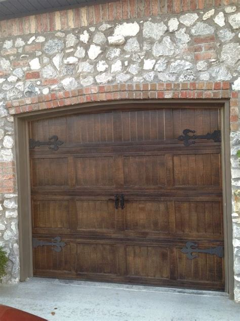 Wood Looking Garage Doors Metal Garage Doors Painted To Look Like Wood With Fluer De Lis Hardware For The Cottage Look