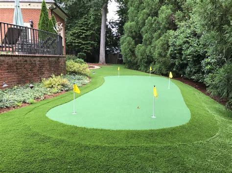 custom synthetic golf green completes backyard east