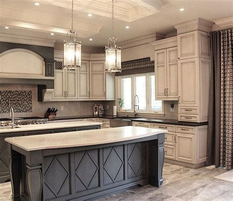 white kitchen cabinets with black island dark grey island with white countertop and antique white