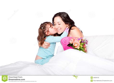 bed moms child gives flowers and kiss to mom in bed stock image