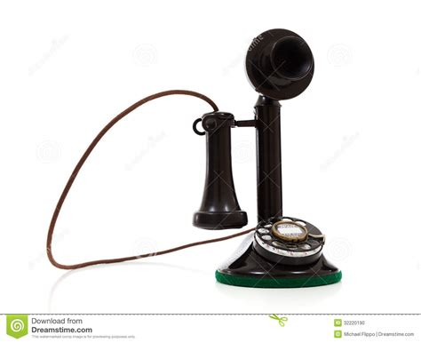 a black candlestick phone on a white background stock