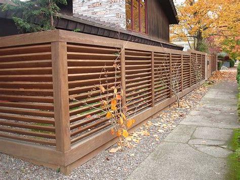 modern backyard fence angled slats fence gardens home