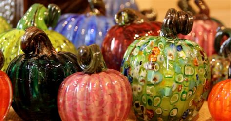 glass pumpkins   tunnel  trees fall color