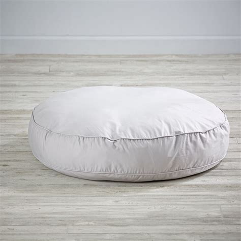 white floor cushion floor pillows poufs the land of nod