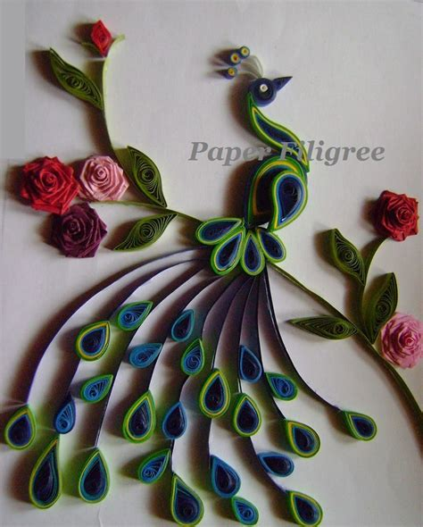 Paper Quilling Craft Ideas - an paper quilled peacock is a picture frame which