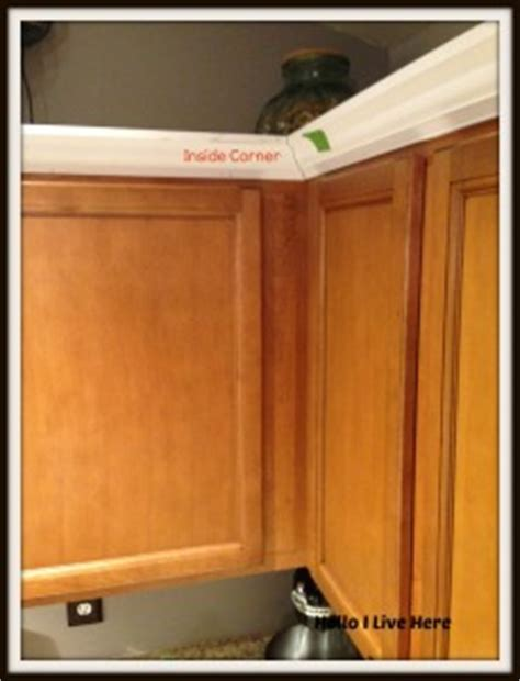 cutting crown molding for corner cabinets kitchen cabinet makeover install crown molding hello