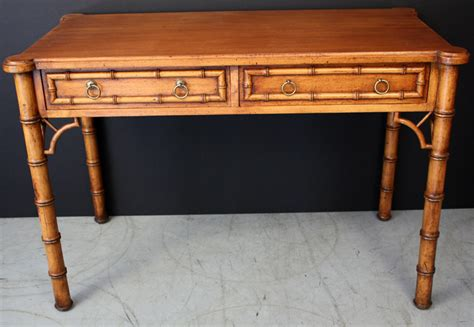 faux bamboo writing desk with two drawers and fret work