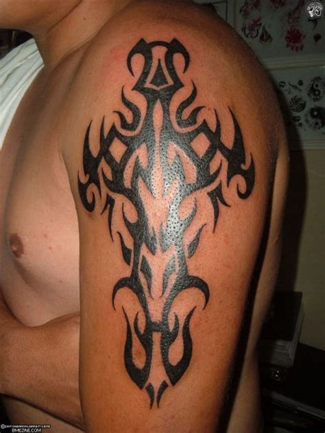 thick tribal arm tattoos studio symmetrical tribal on his