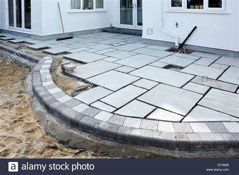 Buy Patio Slabs by Paving Slabs Being Laid As A Patio To Back Garden Of