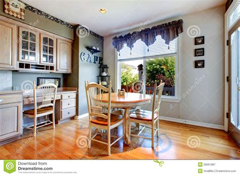 Dining Table Near Kitchen With Wood Floor. Royalty Free