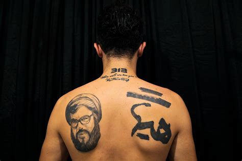 tattoo in islam shia hezbollah supporters tattoo nasrallahs face on their chest