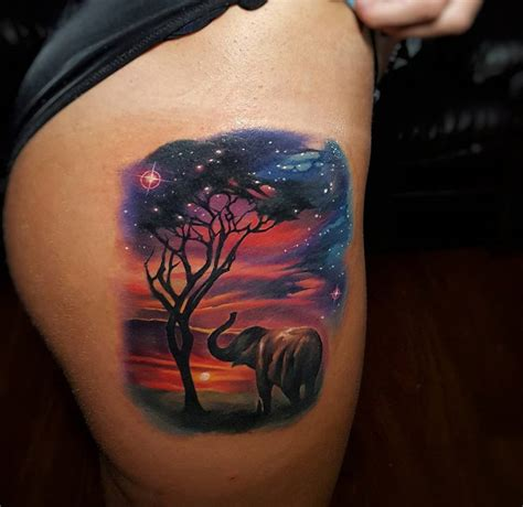 beautiful sunset with an elephant amp tree best tattoo