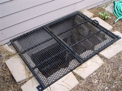 basement window well grates egress window grate maybe with plexiglass it so that