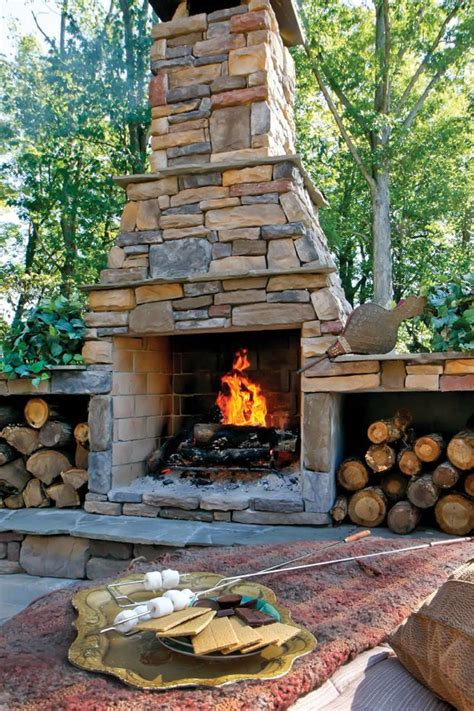 unique stone table with fireplace completing outdoor 17 images about outdoor greatroom on pinterest key