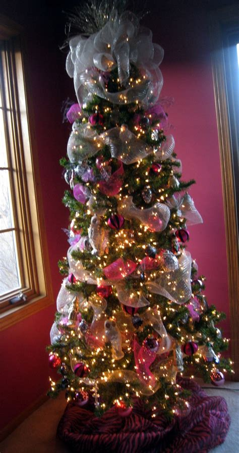pink silver and black christmas tree in a pink dining