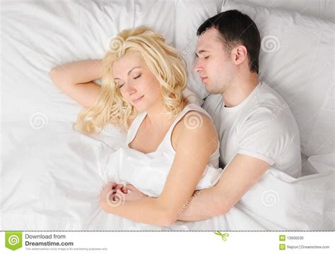 couples in bed couple sleeping in a bed stock photo image 13600530