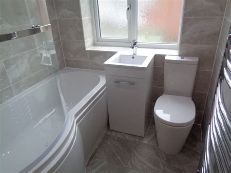 grey bathroom wall and floor tiles bathroom converted to new style bathroom with p shaped bath