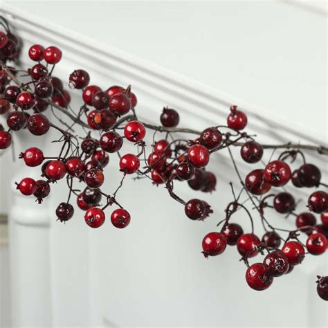 red artificial berry and twig garland christmas garlands