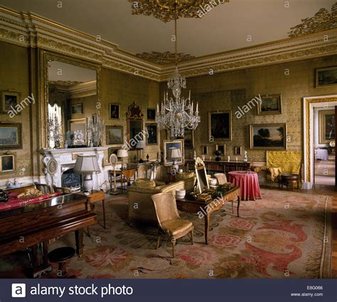 stately home interior large glass chandelier and antique silk carpet in