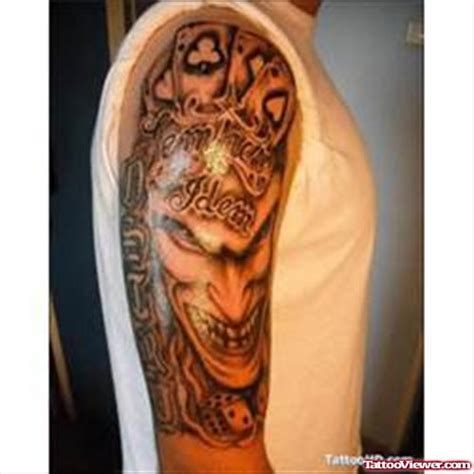 joker tattoo right bicep joker head and casino gambling tattoo on right arm