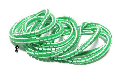 green white plastic cable or wire cover