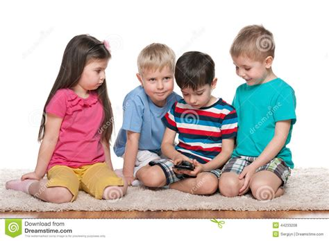 gadget new four kids with a new gadget stock photo image of